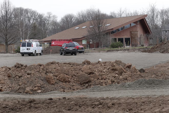 The parking lot at the Scheig Center is under construction at Memorial Park in Appleton.