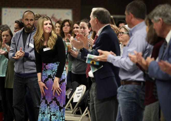 Erin Stoffel receives a standing ovation after being recognized during the 2018 Neenah Heroes Ceremony at Neenah High School.