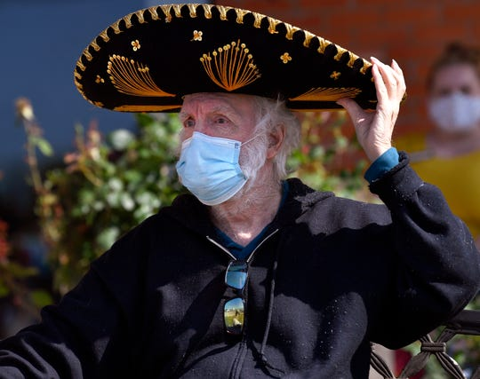 Don King gets into the spirit of the holiday as he watches the Cinco de Mayo parade drive past Willow Springs Health and Rehabilitation Center.