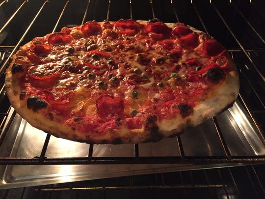 Pizza on Earth recommends reheating its takeout pies in the oven for eight to 10 minutes.