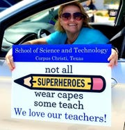 Angela Wright, a second-grade teacher at the School of Science and Technology in Corpus Christi, shows off a yard sign she was given in honor of Teacher Appreciation Week on Monday, May 4, 2020.