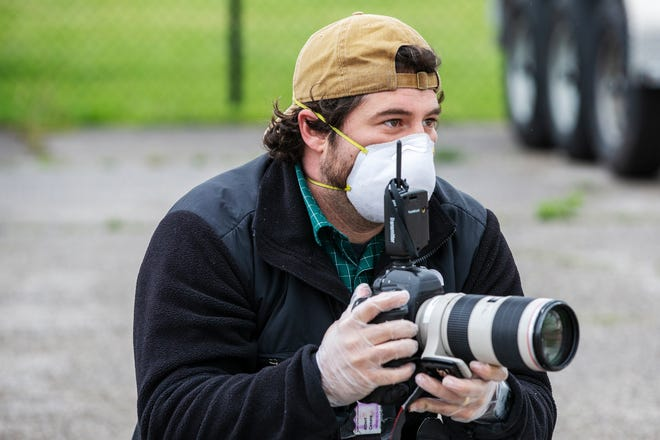 Enquirer photojournalist Albert Cesare on assignment in April.