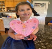 An Albrook preschool student decorated a paper heart to display on her front door to show appreciation for the healthcare professionals.