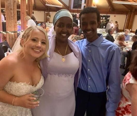 """Abdi"" Sharif, right, is shown with his mother Fadumo Ahmed, center, and family friend Emily Levine at Levine's wedding Sept. 1, 2019."