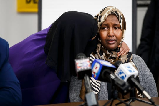 "Fadumo Ahmed, the mother of missing Des Moines teenager Abdullahi ""Abdi"" Sharif gets a word of support during a press conference at Iowa CCI on Tuesday, May 5, 2020, in Des Moines. Sharif's body was found on Saturday 3:10 p.m. in the Des Moines River at Prospect Park. ""He was the father of this house,"" Ahmed said of her son who would spend his earnings from a job at Target on his family before himself."