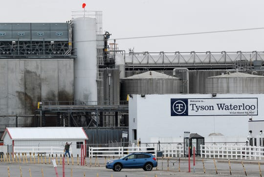 A worker leaves the Tyson Foods plant on May 1 in Waterloo, Iowa. The coronavirus is devastating the nation's meatpacking communities, places like Waterloo and Sioux City in Iowa, Grand Island, Neb., and Worthington, Minn. Within weeks, the outbreaks around slaughterhouses have turned into full-scale disasters.