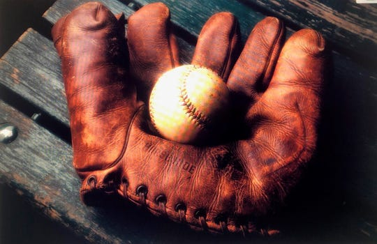 Baseball and glove photographed by Michigan commercial photographer Tony Segielski.