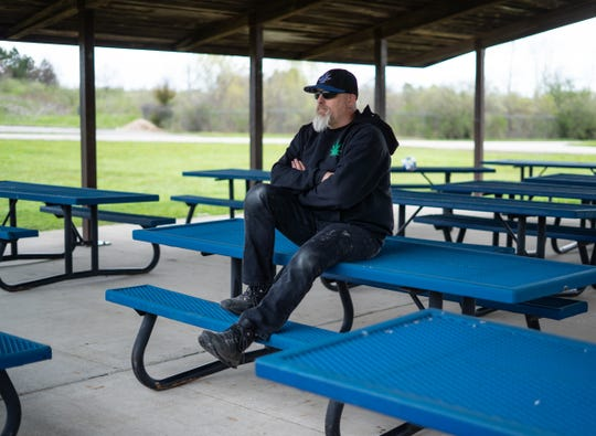 Brian Cash poses for a photo at a pavilion behind The South Lyon Fire Department on May 5, 2020. Cash is the man from the Michigan Capitol protest photos who appears to be yelling at two MSP troopers and is being mistaken for a white supremacist from LA on Twitter.
