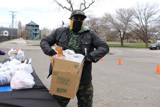 New Era Detroit President and CEO Zeek delivering food and other essential items to those in need in Detroit.
