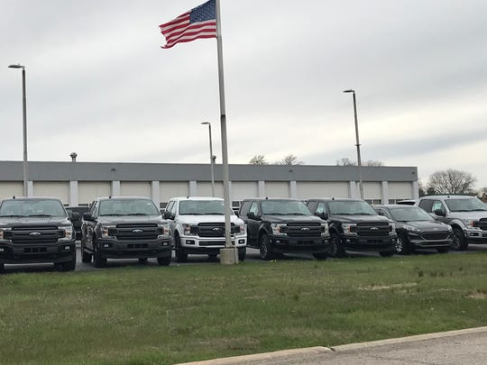 Ford trucks and SUVs sit on the lot at Dean Sellers Ford of Troy on May 5.  Sales floors remain closed under the governor's emergency orders.
