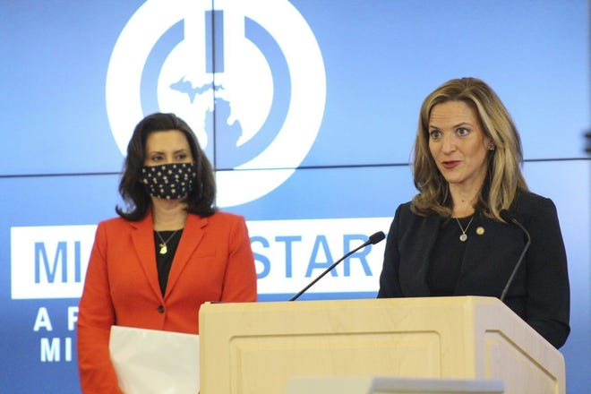 Gov. Gretchen Whitmer and Michigan Secretary of State Jocelyn Benson  is shown at a coronavirus update in Lansing on Monday, May 4, 2020.