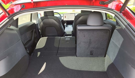 Flatten the Tesla Model Y's rear seats and it gains a whopping 68 cubic feet of cargo room.