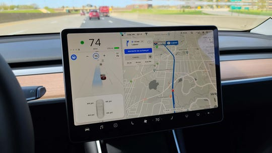The Tesla Model Y will change lanes automatically on I-75 while following a nav route.