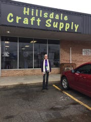 Shelley Mangus stands in front of her store in Hillsdale Michigan.