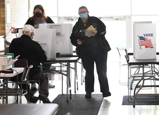 Voters cast their ballots' during absentee voting at Garden City City Hall.