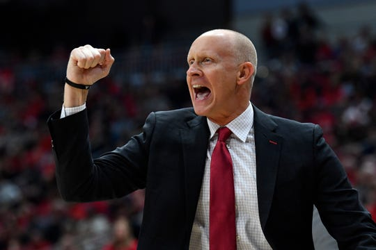 In this Dec. 6, 2019, file photo, Louisville head coach Chris Mack reacts to a play during the first half of an NCAA college basketball game in Louisville, Ky.