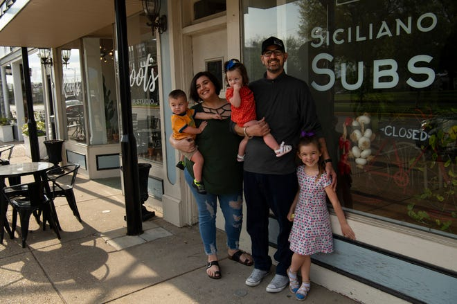 "David and Danielle Hodge with their three children, Miles, 1, Sylvie, 1, and Olivia, 4, will be doing a ""soft re-opening"" of their Siciliano Subs shop at 2021 W. Franklin Street on May 18, 2020, from 11 a.m. - 3 p.m. They will only be doing carry-out – while wearing masks and gloves – because their shop is too small to do social distancing dining."