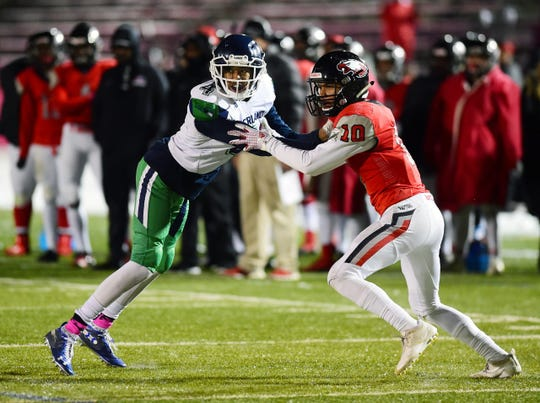Eaglecrest's Langston Williams, right, has verbally committed to join the Colorado State football team.
