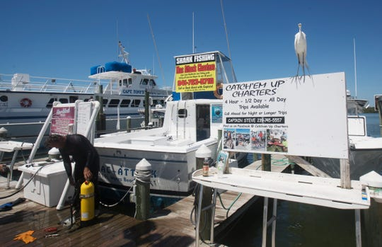 Lewis MacDonald, the owner of Mac Attack Charters based out of Getaway Marina works near his boat on Tuesday, May 5, 2020.  Like most other industries, the COVID-19 pandemic hit charters really hard. He said he lost 23 trips out of 41 days. So far he says he can weather the storm. He saved up for the lean months and got a business loan. He believes some the charter businesses near him may not make it.  He is also starting to get charters from locals who need to get out.