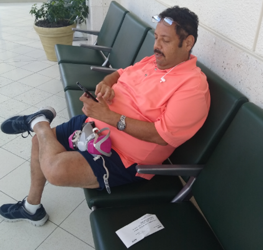 Carlos Marez of New Jersey waits in vain Tuesday, May 5, 2020, at Southwest Florida International Airport for a chance to change his return booking for a flight to the Garden State. The Spirit Airlines ticket counter was closed and the airline had no departures scheduled Tuesday afternoon or evening.