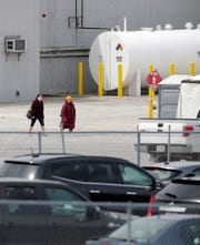 Employees exit JBS Packerland on May 5, 2020, after the Green Bay beef plant reopened following a brief closure due to a coronavirus outbreak amongst workers.