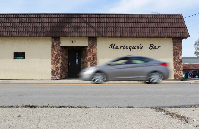 A car passes Maricque's Bar, 1517 University Ave., on Tuesday. The bar will reopen for pickup orders on May 29.