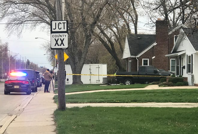 Authorities investigate the scene of what appears to have been a murder-suicide in Allouez on Monday, May 4, 2020.
