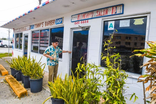 """Despite an """"open"""" sign hanging in a window, Tamuning resident Scott Weiss only finds disappoinment after discovering a locked door to the Little Tommy's Barber Shop and other similar businesses on Tuesday, May 5, 2020. Weiss says he was hoping to find a place to get a needed haircut."""