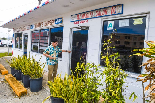 "Despite an ""open"" sign hanging in a window, Tamuning resident Scott Weiss only finds disappoinment after discovering a locked door to the Little Tommy's Barber Shop and other similar businesses on Tuesday, May 5, 2020. Weiss says he was hoping to find a place to get a needed haircut."