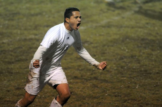 HCHS's Darwin Zeron (13) celebrates a goal during the Colonels' district championship match against Madisonville in Union County on, Octber 14, 2009.