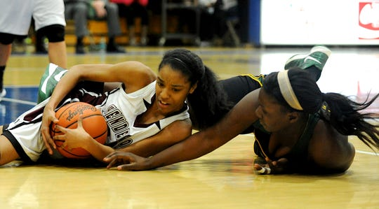 Henderson County's DeAsia Outlaw, left, scuffles with UHA's Cache Richardson, right, for a loose ball during the 2013 Second Region championship game at Caldwell County High School.