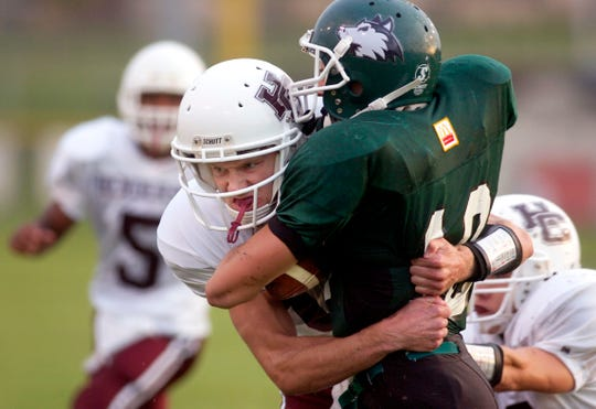 Henderson County's Colonel Chris LaMar makes a defensive stop on North's Brant Jackson at Central Stadium on Aug. 26, 2005.