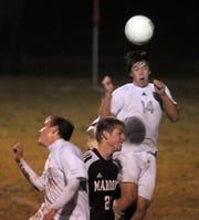 Henderson County's Brandon Potts (14) tries to head the ball in the goal on a corner kick play during the 2009 district championship game against Madisonville October 14, 2009. Henderson won 7-4.