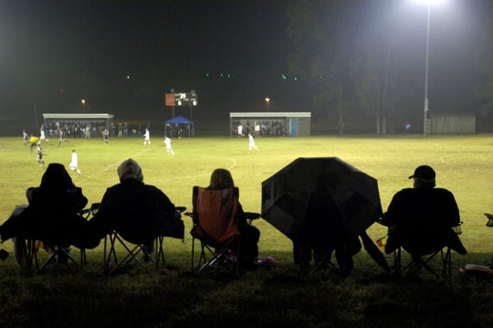 Fans line the top of the hill as they watch the start of the district championship game between Henderson and Madisonville in Union County Wednesday night, October 14, 2009. (Gleaner photo by Darrin Phegley • 831-8375 or dphegley@thegleaner.com)