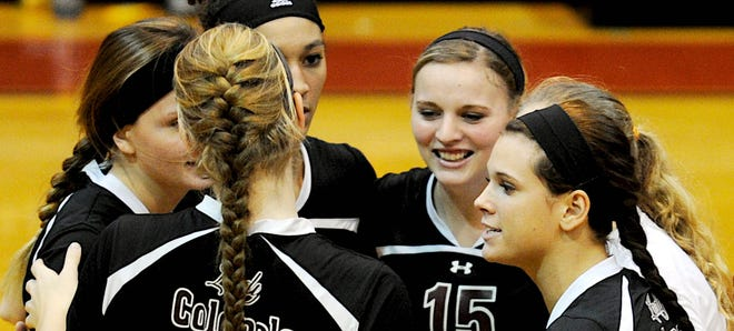 Henderson County celebrates a point during the 2013 Second Region Tournament semifinal against University Heights at Livingston Central High School.
