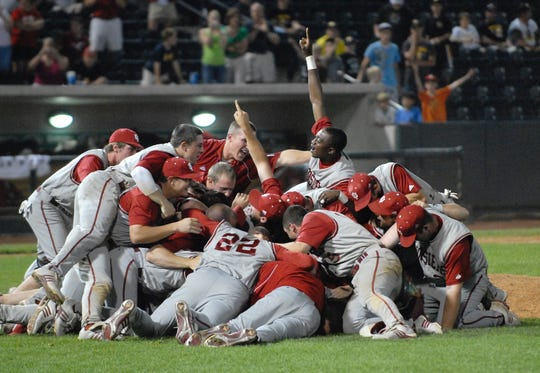 IU players celebrate at the pitcher's mound in 2009.