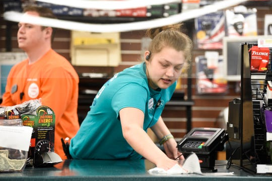 Pilot employee Seanna Scheff cleans the counter at the Watt Road Flying J Travel Center, Friday, April, 17, 2020. Pilot has taken extra precautions to slow the spread of coronavirus at their locations. Pilot has since made it mandatory for employees to wear masks.