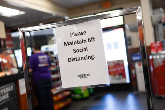 A sign is seen in the Watt Road Flying J Travel Center, Friday, April, 17, 2020. Pilot has taken extra precautions to slow the spread of coronavirus at their locations.