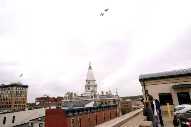 A pair of A-10 Thunderbolt II fighter jets from the Indiana Air National Guard 122nd Fighter Wing fly above Lafayette in a salute frontline workers battling the coronavirus pandemic, Tuesday, May 5, 2020.