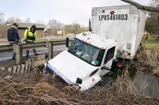 A U.S. Postal Service truck driver was not injured after the truck he was driving crashed into Chilson Creek off M-36 east of Island Shore Drive in Hamburg Tuesday, May 5, 2020.