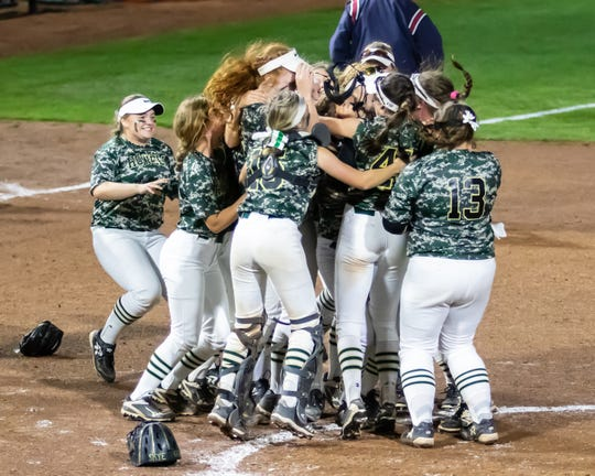 Howell celebrates a 9-6 victory over Clarkston in the state Division 1 softball semifinals on Thursday, June 13, 2019.