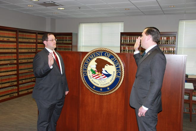 Mark Yurchisin, (left) is sworn in by U.S. Attorney Russell Coleman to become Bowling Green's second full-time federal prosecutor