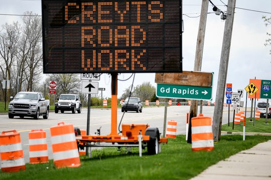 Signs alert motorists to the coming construction on the Creyts Road bridge over Interstate-496 on Tuesday, May 5, 2020.