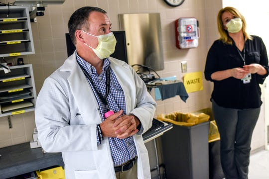 Dr. Michael Markey, left, and Michelle Fox, forensic pathology supervisor, talk about their work during the coronavirus pandemic in the morgue on Monday, May 4, 2020, at Sparrow Hospital in Lansing.