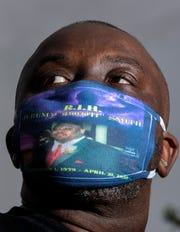 Mark Hearns wears a protective mask honoring his cousin Jeremy Smith, the same one he wore to his cousin's funeral, one of the first people in Memphis to succumb to COVID-19.
