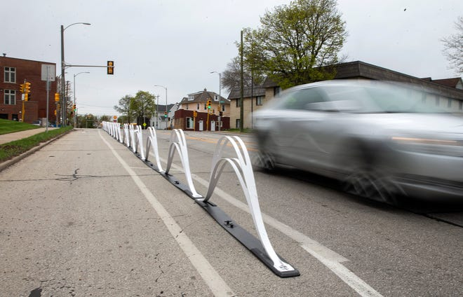 Wave delineators are placed to divide bike lane and driving lane and automobile lanes on Tuesday, May 5, 2020 on North Hawley Road.