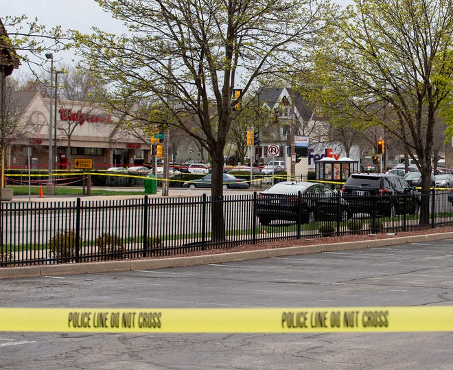 Milwaukee police block the streets around the Walgreens at North 27th Street and West North Avenue to investigate a shooting Tuesday.