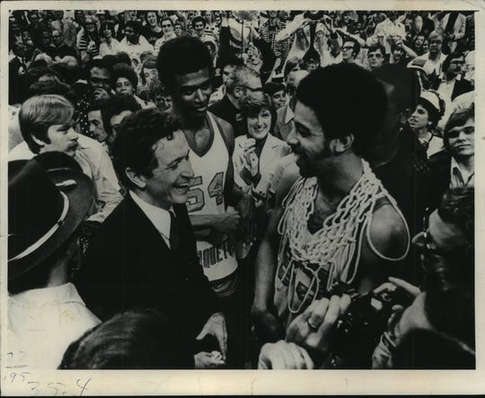 Coach Al McGuire and players Jerome Whitehead (center) and Bernard Toone in 1977 after winning the national title.
