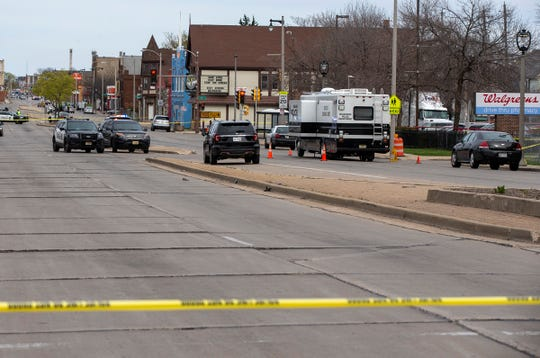 MPD officers block the streets around the Walgreens at 27th Street and North Avenue on Tuesday after a woman was shot and killed by a man outside the store Tuesday.
