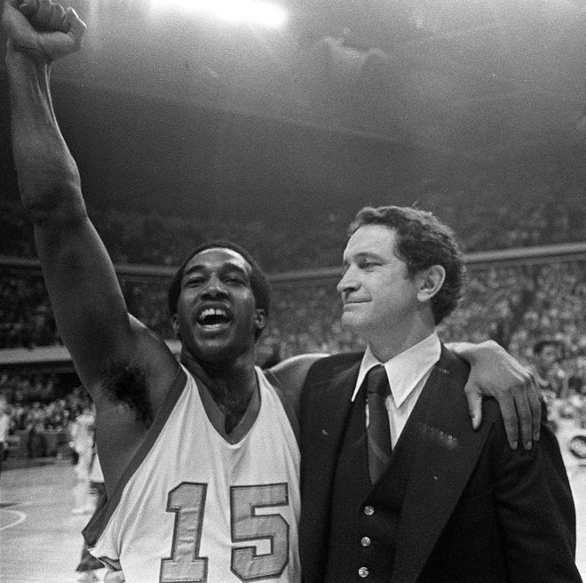 Marquette University basketball player Butch Lee, left, and his coach Al McGuire smile after the Marquette beat UNCC, 51-49, on a last second shot in the NCAA semifinals.